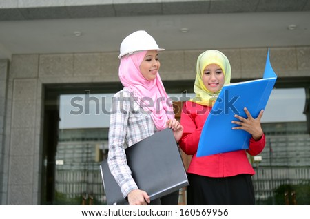 beautiful young muslim businesswoman busy at work - stock photo