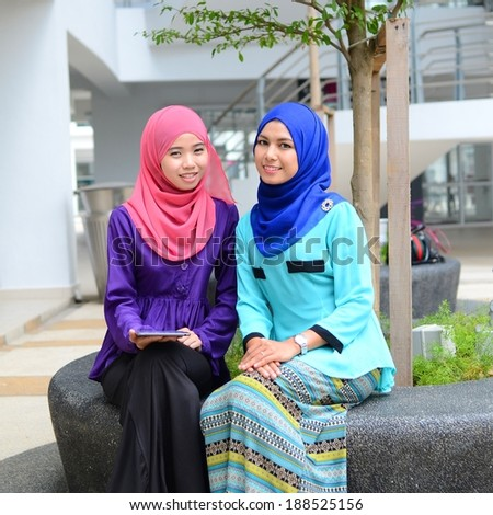 beautiful young muslim student happy together
