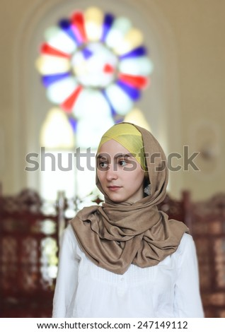Beautiful Young Muslim Woman in the Mosque. - stock photo