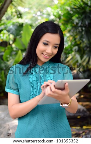 Beautiful young muslim woman smile with laptop - stock photo