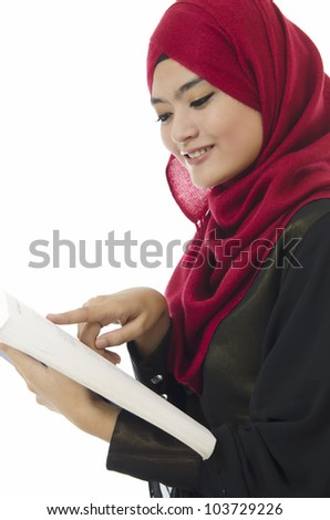 Beautiful young Muslim women read a book. Isolated on white background. - stock photo
