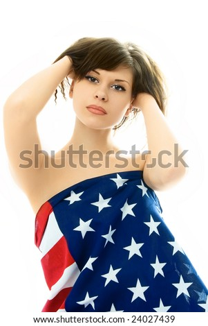 beautiful young nude woman with her hands in her hair wrapped into an American flag - stock photo