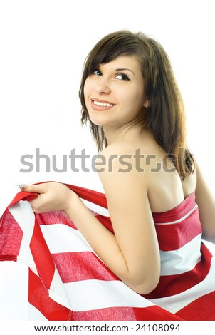 beautiful young nude woman wrapped into the American flag - stock photo