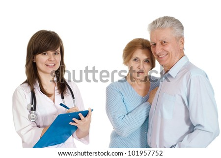 Beautiful young Nurse with elderly patient on a light background - stock photo