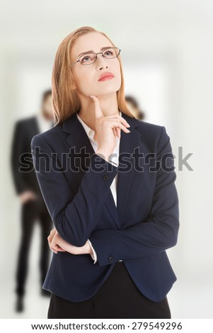 Beautiful young pensive business woman in glasses. - stock photo