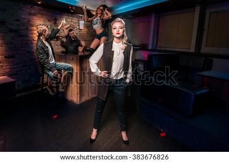Beautiful Young people having fun at night club - stock photo