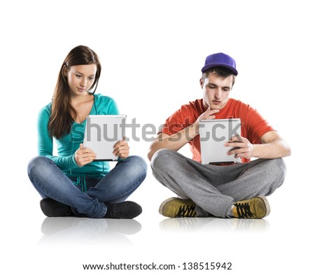 Beautiful young people with tablet in studio - stock photo