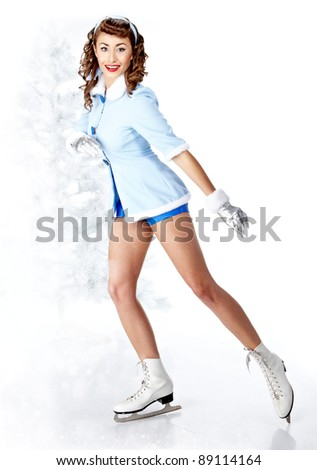 beautiful young pin-up woman going to ice skating - stock photo