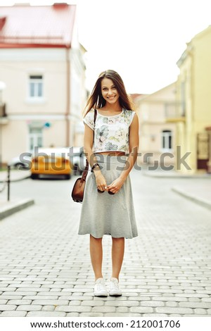 Beautiful young pretty girl smiling - stock photo