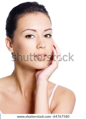 Beautiful young pretty woman's portrait with healthy clean face - isolated - stock photo