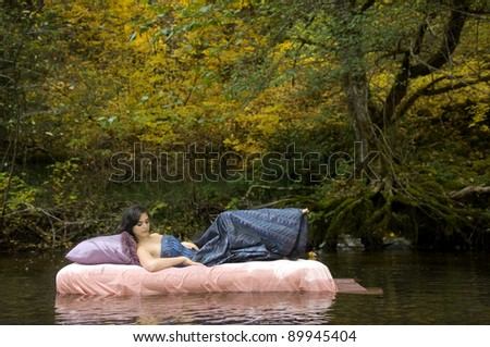 Beautiful Young Princess Awakens in Woodland Stream - stock photo