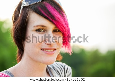 Beautiful young punk woman with pink hair outdoor portrait - stock photo