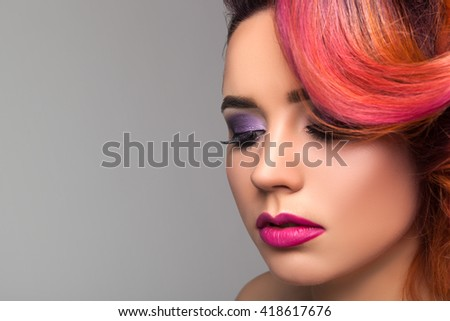 Beautiful young red hair girl with makeup. - stock photo