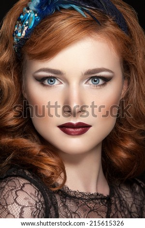 beautiful young red hair woman with red lips and perfect skin. Evening make-up. Trendy makeup - stock photo
