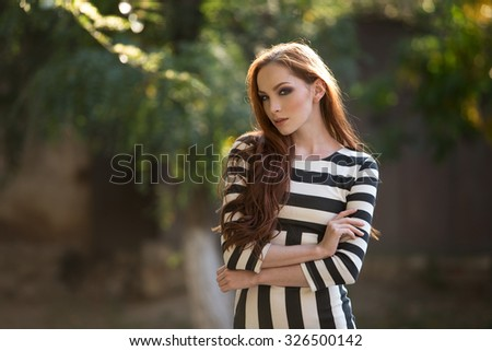 Beautiful young redhead outdoors