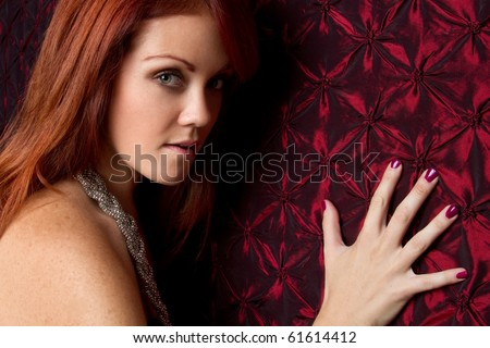 Beautiful young redhead woman - stock photo