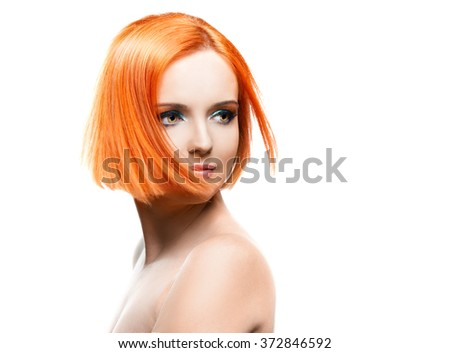 Beautiful young redhead woman isolated on white background, in motion - stock photo