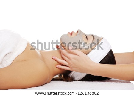 Beautiful young relaxed woman enjoy receiving head massage at spa saloon - stock photo