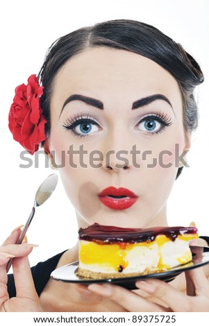 beautiful young retro pinup  woman eat sweet cake food isolated on white iin studio, representing diet and healthy concept - stock photo