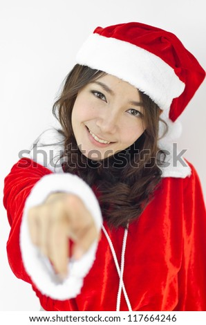 Beautiful young santa clause woman in christmas clothes smiling . isolated on white background