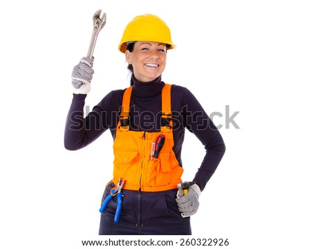 Beautiful young servicewoman in hardhat holding wrench, hammer, pliers and screwdriver, Isolated on white background - stock photo