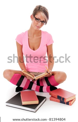 Beautiful Young Sexy College Woman Studying isolated on white - stock photo