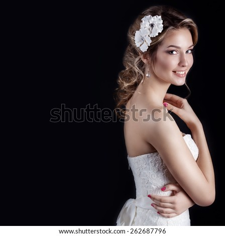 beautiful young sexy elegant happy smiling woman with red lips, beautiful stylish hairstyle with white flowers in her hair, the way for the bride at a wedding - stock photo