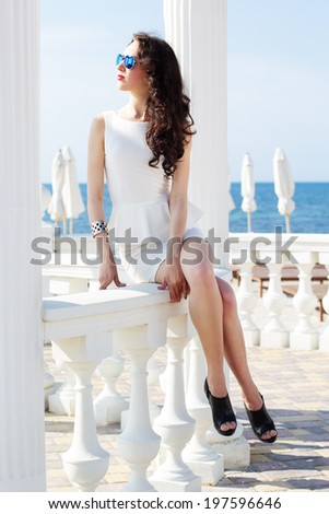 Beautiful young sexy fashion model by the sea  - stock photo