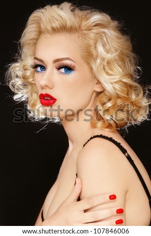 Beautiful young sexy girl with curly blond hair - stock photo