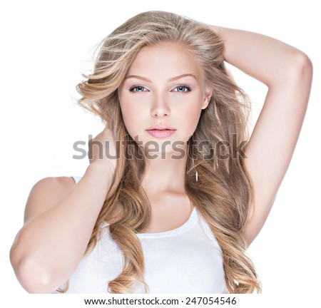 Beautiful young sexy woman with blue eyes and long curly hair looking at camera - isolated on white. - stock photo
