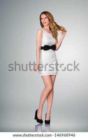 Beautiful young slim woman full body studio portrait - stock photo