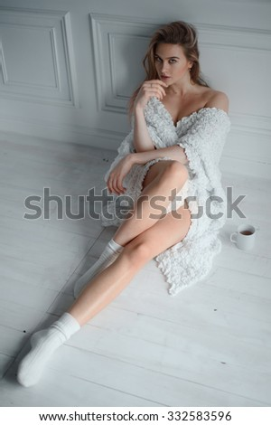 beautiful young slim woman with morning coffee - stock photo