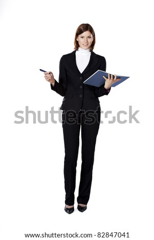 Beautiful young smiling businesswoman holding pen and notepad in her hands - stock photo