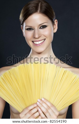 Beautiful young smiling naked woman half covered by a fan of spaghetti