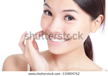 Beautiful young smiling woman hand touch her face and mouth, lips, teeth. Isolated over white background, model is a asian girl - stock photo