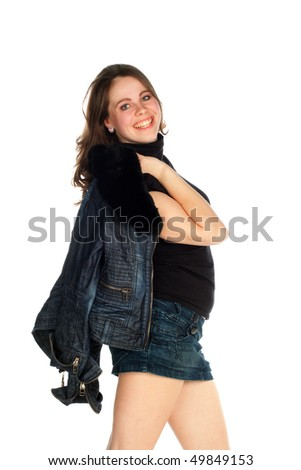 beautiful young smiling woman holding denim jacket over his shoulder
