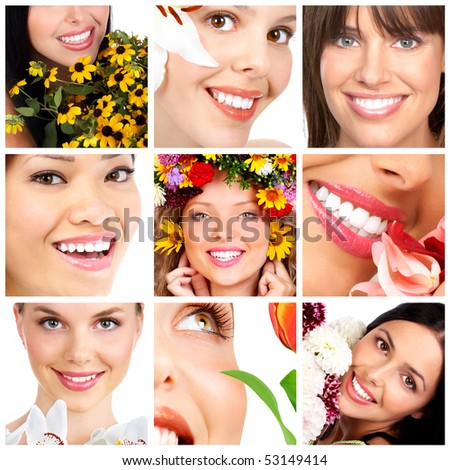 Beautiful young smiling women with flowers. - stock photo