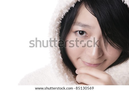 Beautiful young snow queen in winter clothing on cold white background - stock photo