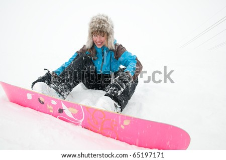 Beautiful young snowboarder - stock photo
