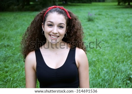 beautiful young spanish woman with dark curly hair                        - stock photo