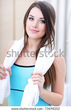Beautiful young sport woman with towel