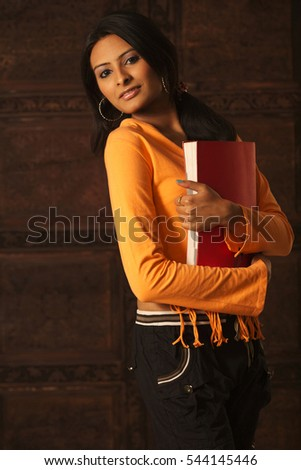 Beautiful young Student isolated against colored background