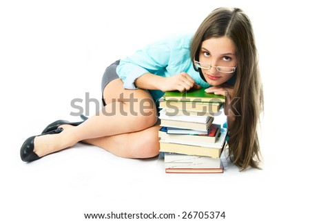 beautiful young student on the floor with a lot of books