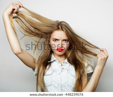 Beautiful young surprised woman.  - stock photo