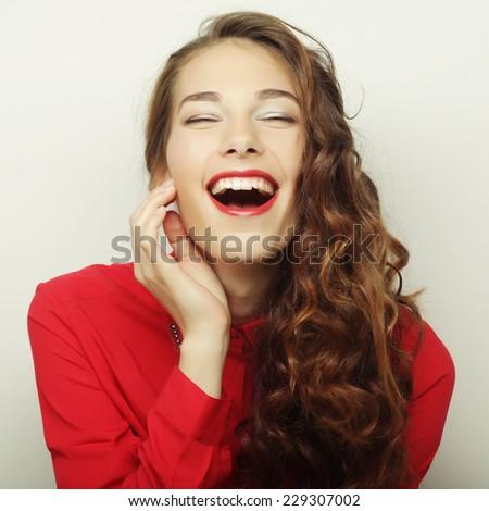 Beautiful young surprised woman. Studio shot.  - stock photo