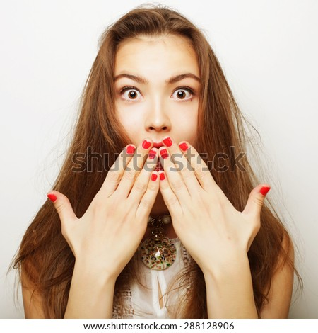 Beautiful young surprised woman. Studio shot.  - stock photo