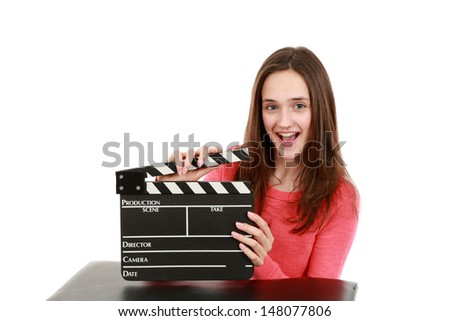 beautiful young teen girl holding an actor's slate smiling - stock photo