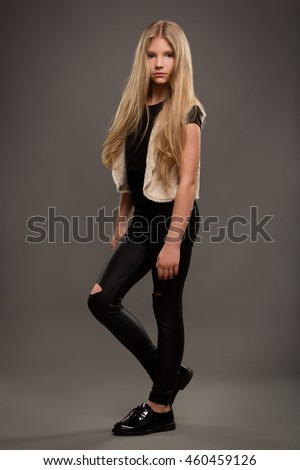 Beautiful young teen girl with long blonde hair with natural make-up