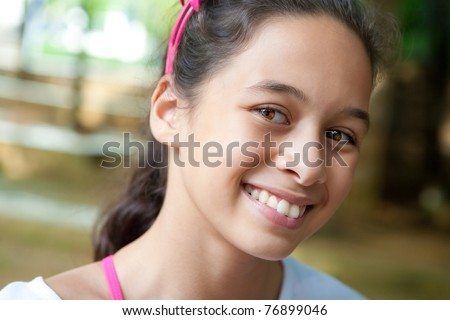 Beautiful young teenager girl outdoor. - stock photo
