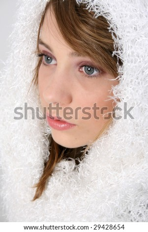 Beautiful young teenager wearing warm winter scarf